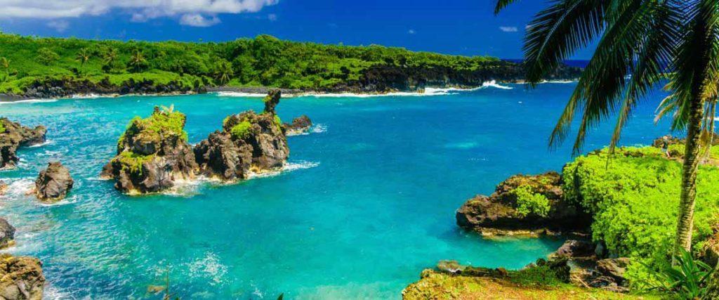 Photo of hawaiian water and volcanic rocks