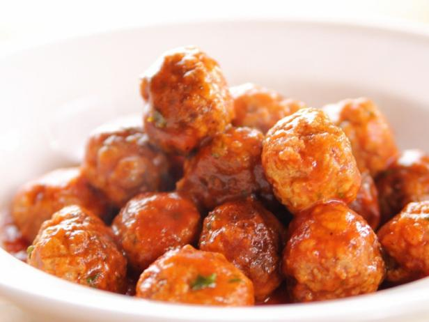 a white bowl of sweet and sour Meatballs