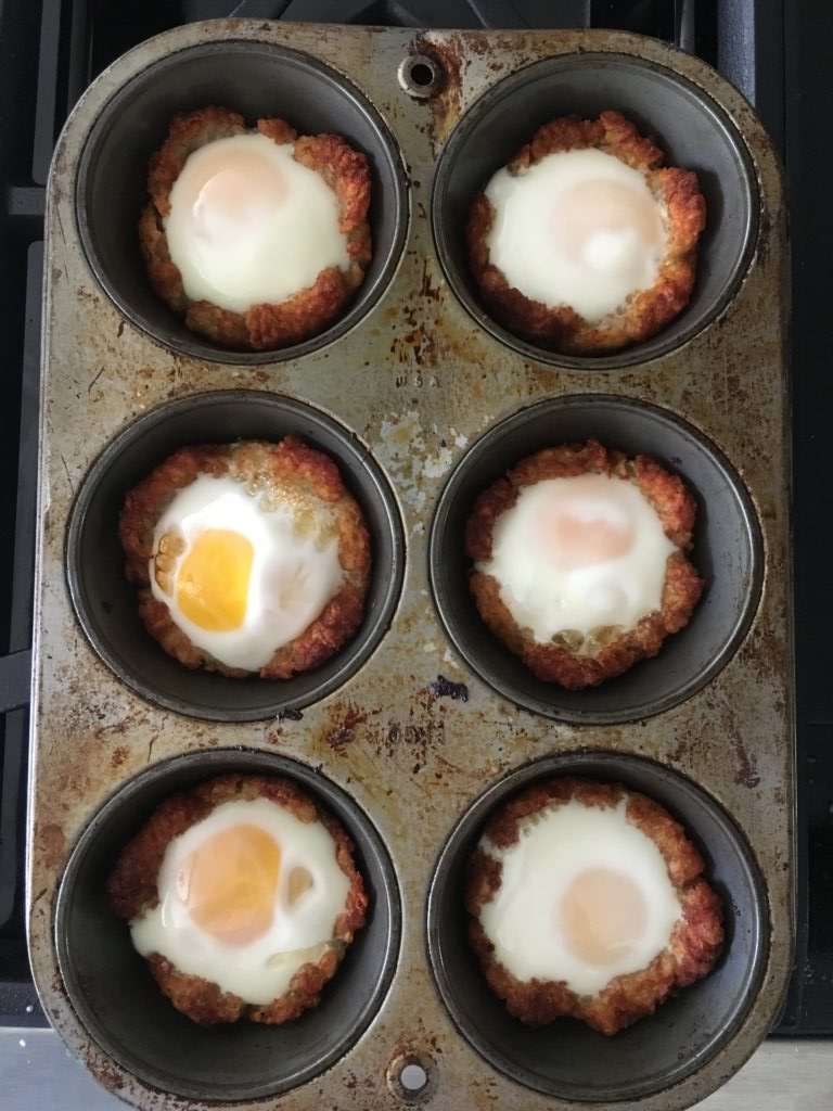 muffin pan with freshly baked tater tot egg nests