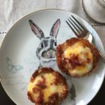 tater tot egg nests on a bunny plate