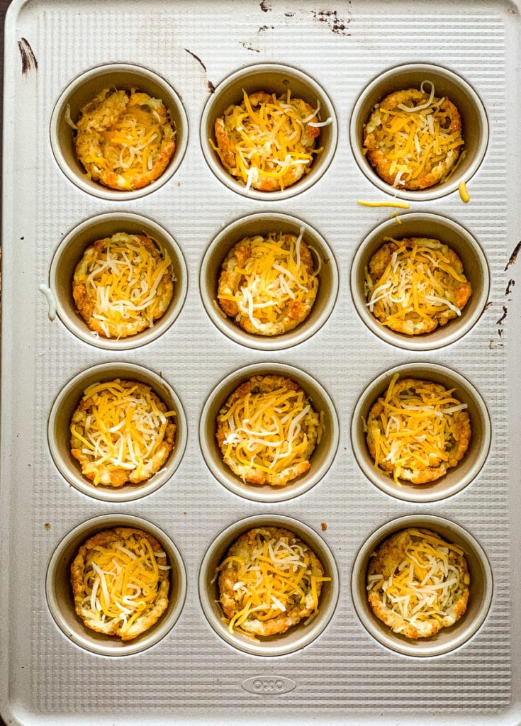 muffin tin with tater tots, cheesy baked tater tots