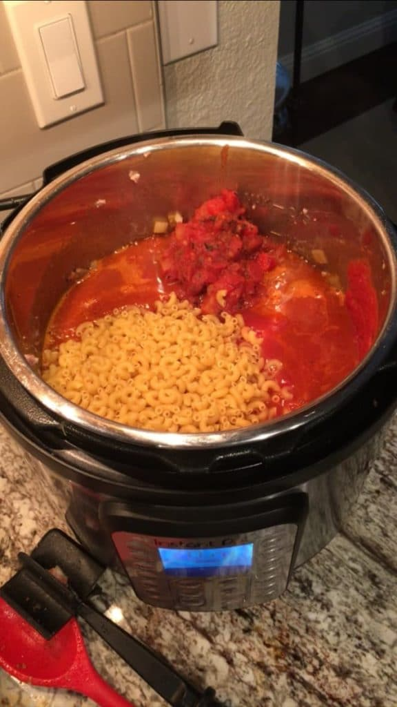 Instant Pot with recipe ingredients ready to cook