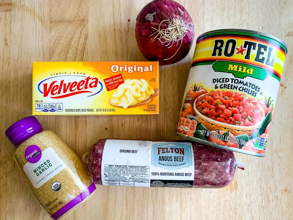 Ingredients for chili cheeseburger soup  can of Rotel onion Velveeta  garlic ground beef