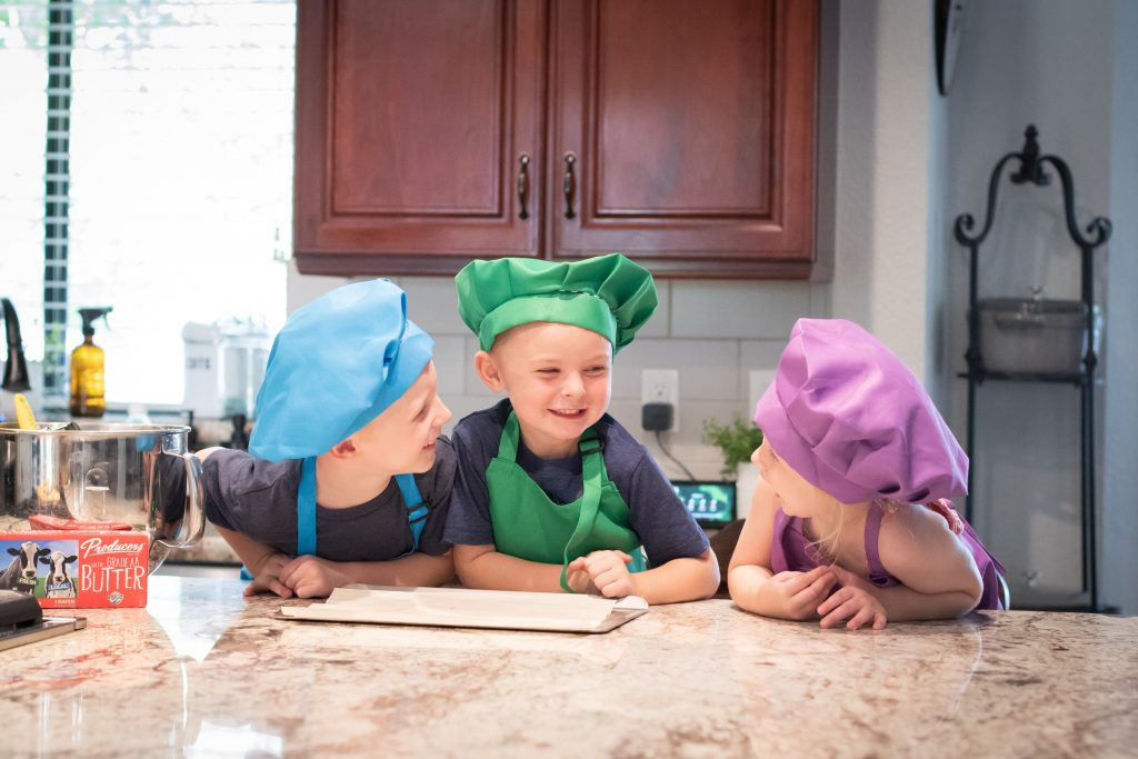 Cooking kids in the kitchen, sharing recipe secrets