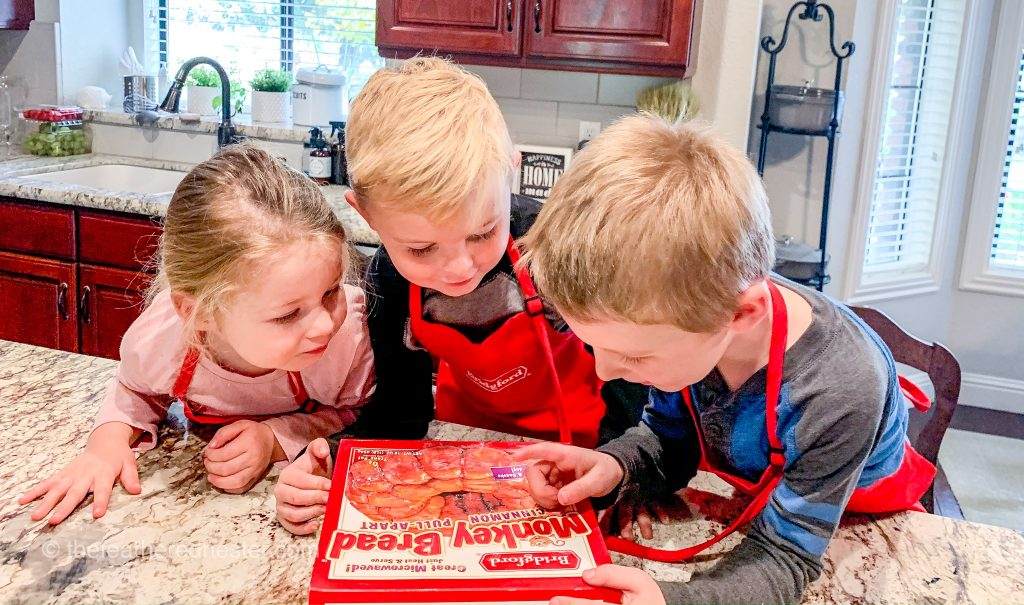 kids looking at the box of frozen monkey dough