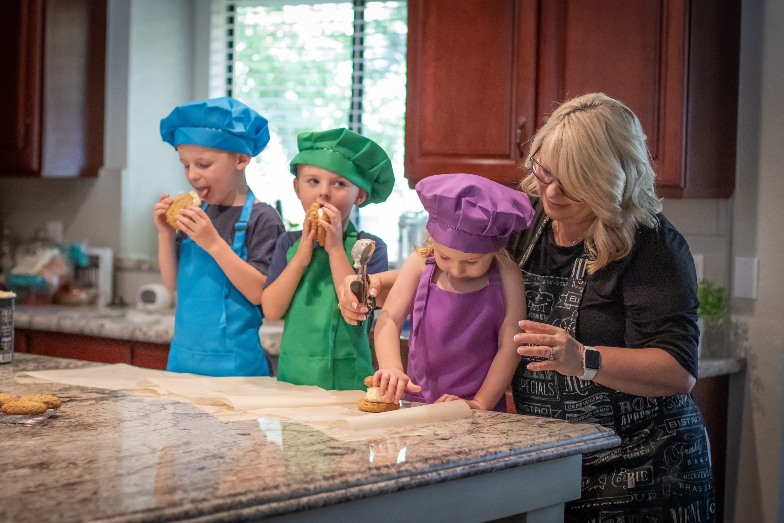 three kids and an adult making the Oatmeal Cookies Recipe