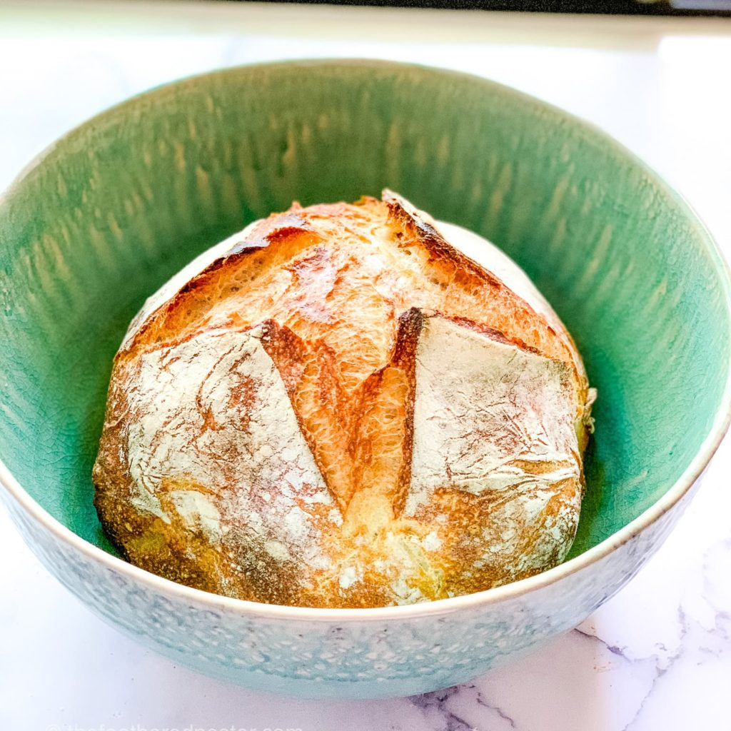 Sourdough Bread in a green bowl perfect to serve with lasagna soup