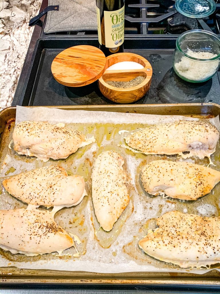 sheet pan of baked chicken breasts