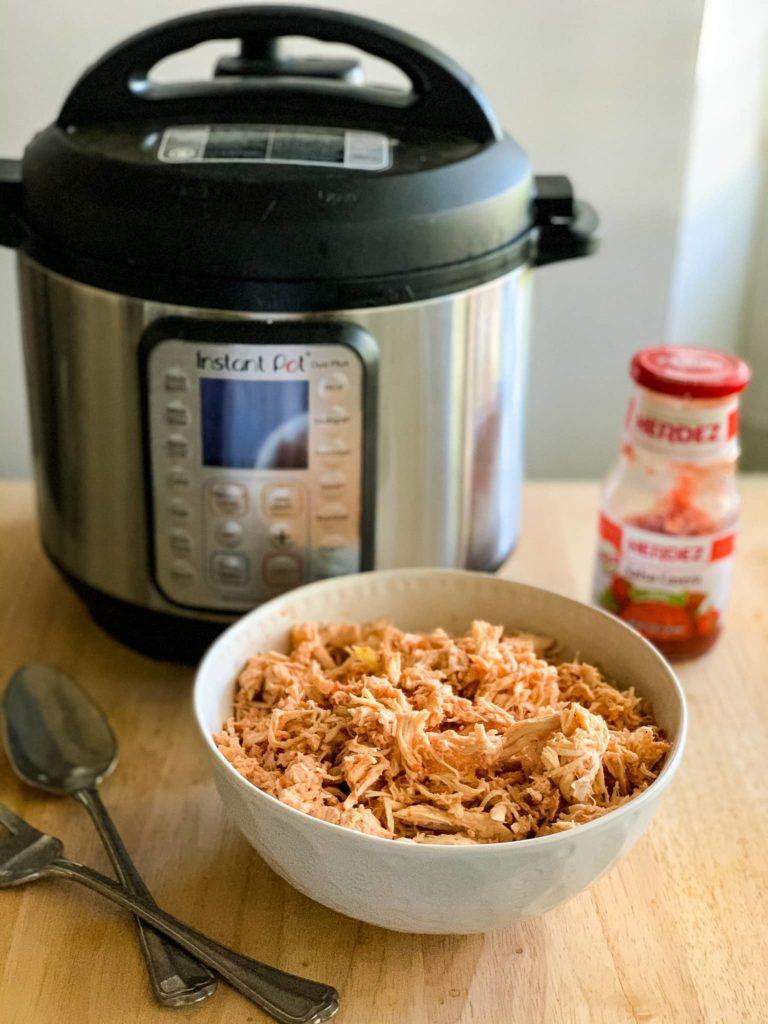 a bowl of shredded Instant Pot Chicken Salsa