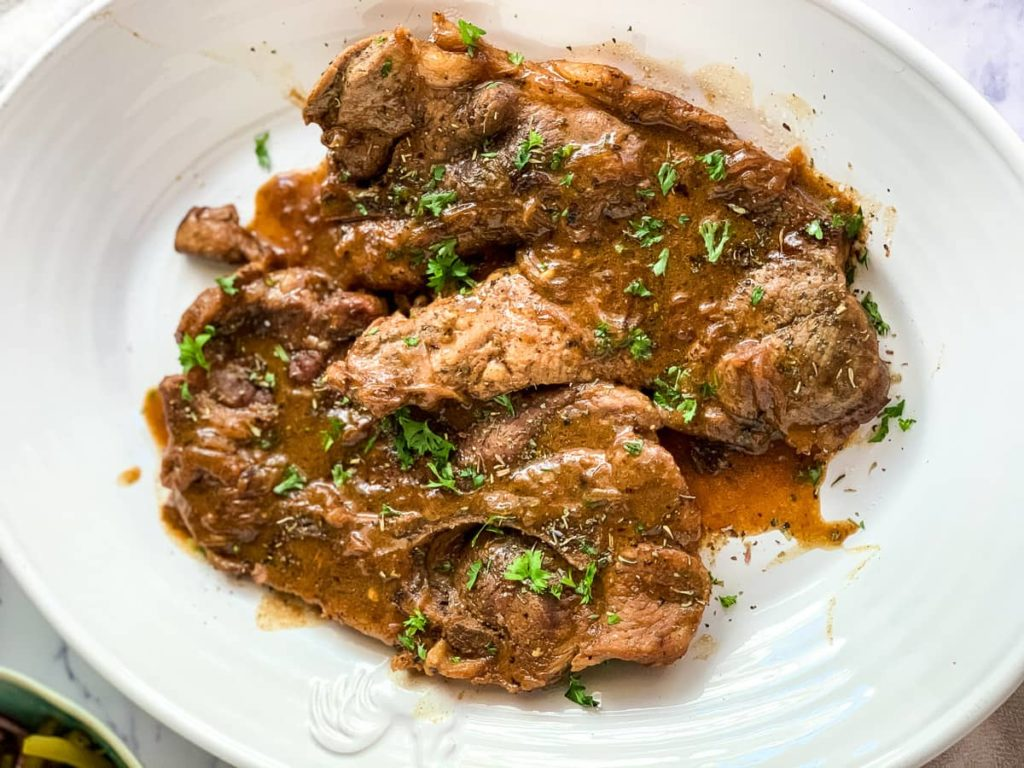 Pork Chops with gravy on a serving platter