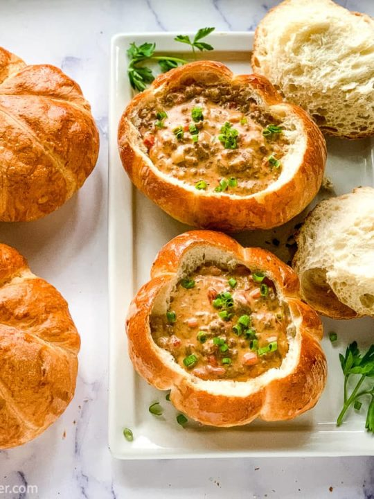 Pumpkin Shaped Bread Bowls filled with Cheeseburger Soup