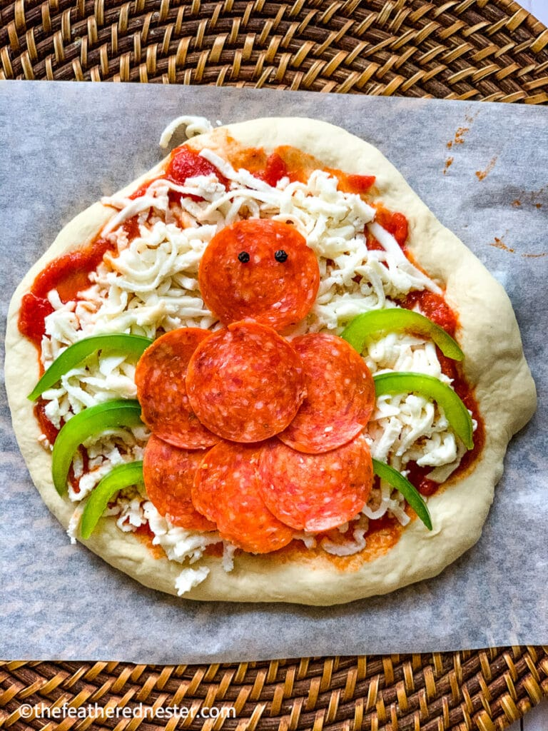 Spider mini pizza made with pepperoni, mozzarella cheese, and bell pepper