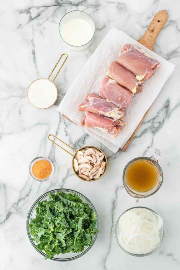 chicken thighs, kale, evaporated milk, chicken broth are all ingredients for this creamy chicken