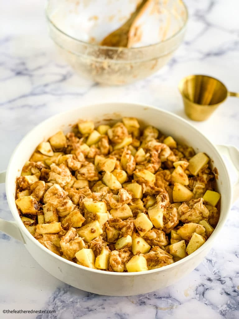chopped dough and apples in a casserole dish