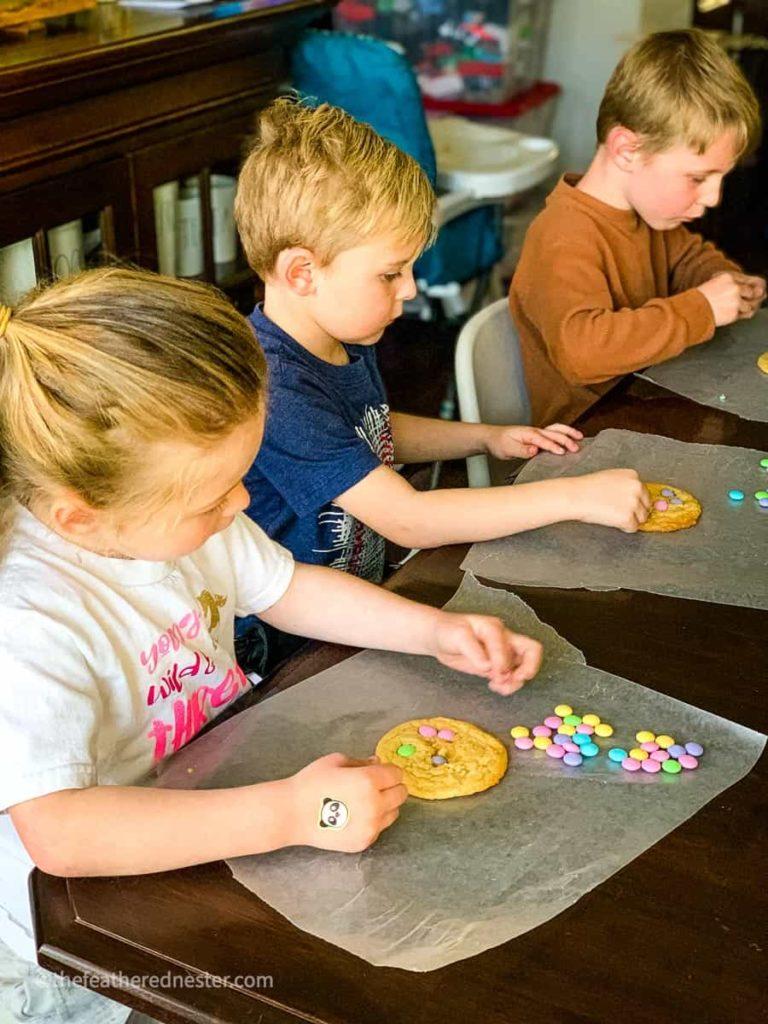 kids making spring sugar cookies with M&Ms