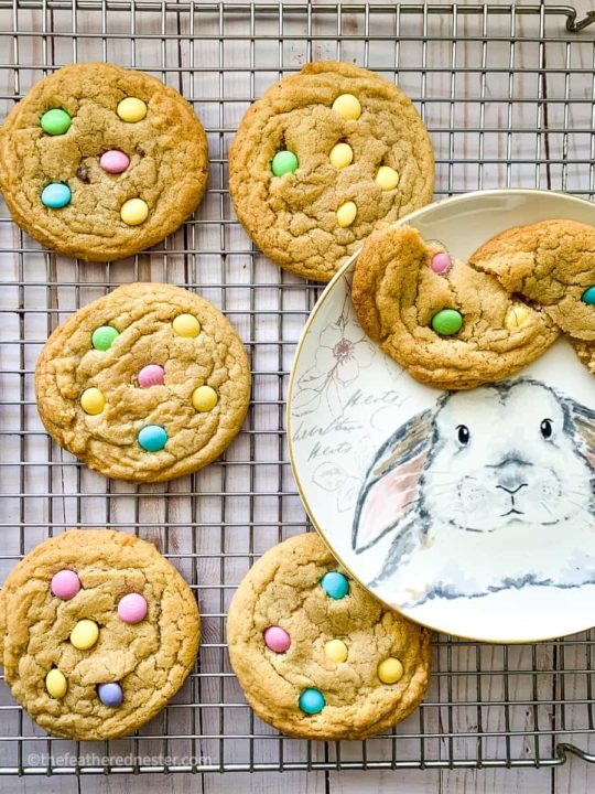 M&M Cookies on a cooling rack and bunny plate