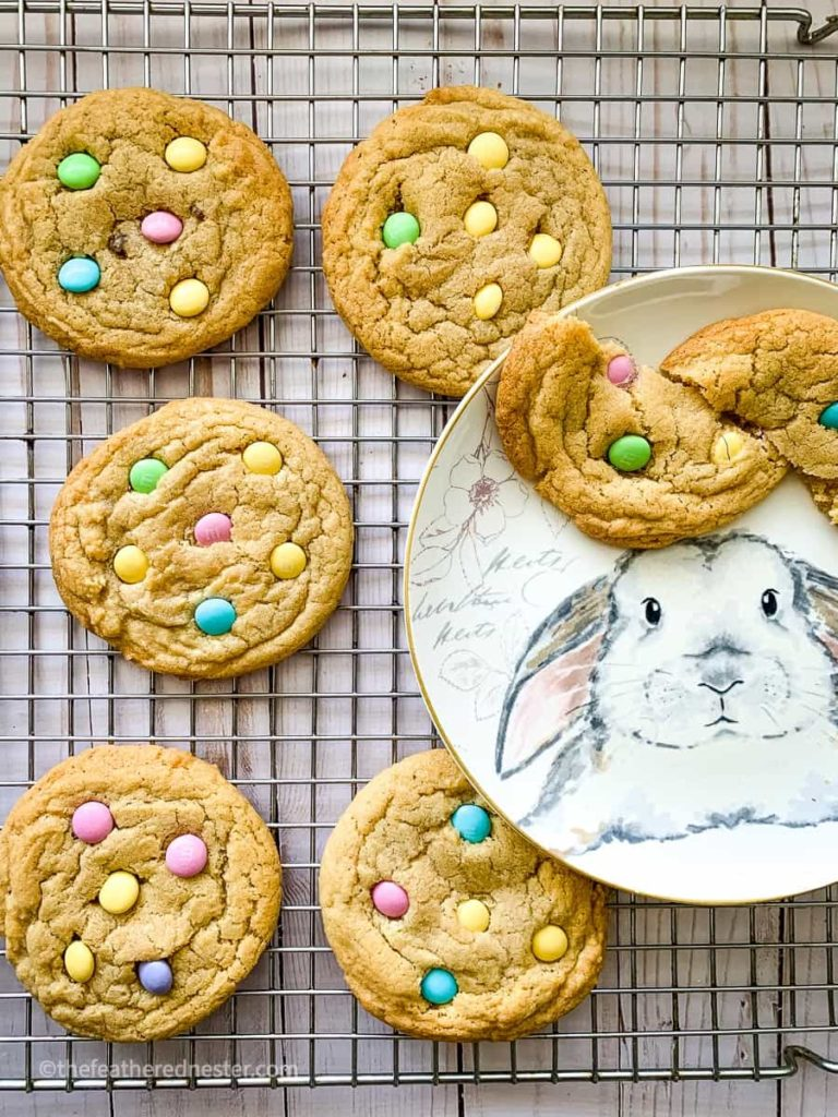 M&M easter cookies on a cooling rack and on top of a bunny plate