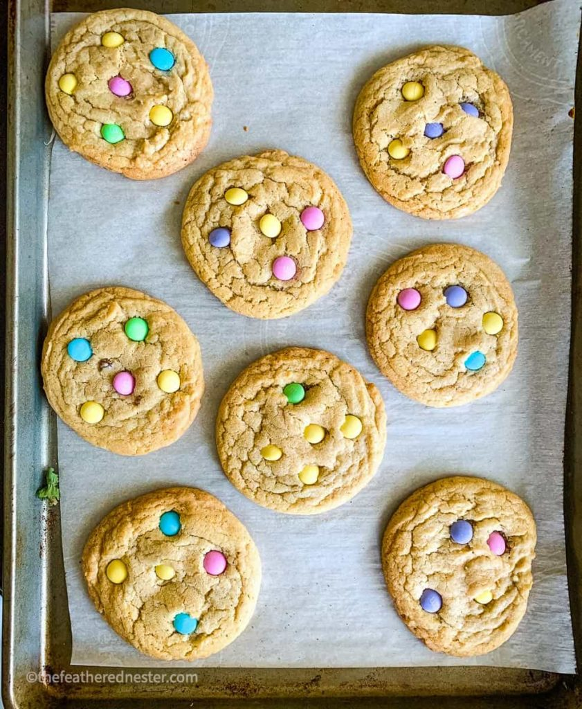 A baking tray of cookies with pastel colored M&Ms which are great ideas