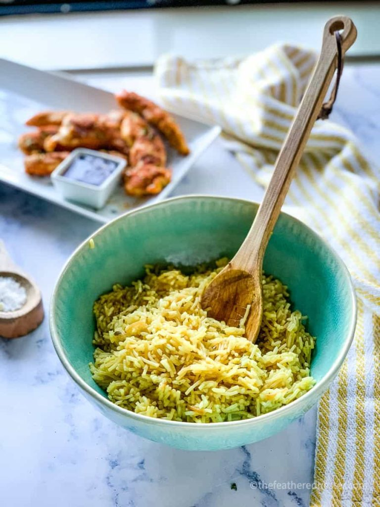 Rice A Roni in a green bowl with a platter of chicken in the background instant pot boxed rice