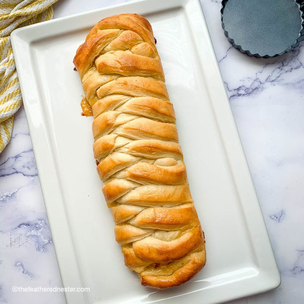 lemon braided bread loaf on a white platter