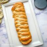 lemon braided bread loaf on a white platter