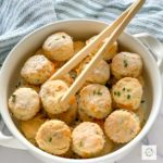 white serving bowl of mini biscuit appetizers