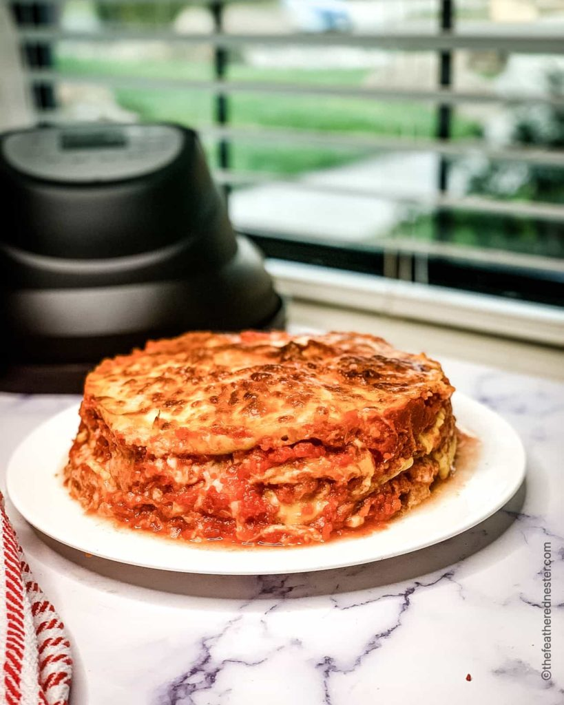 easy lasagna made in the pressure cooker with an air fryer lid in the background