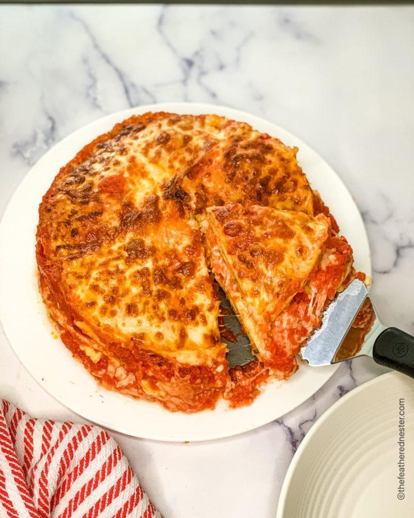 a cut slice of ravioli lasagna ready to serve