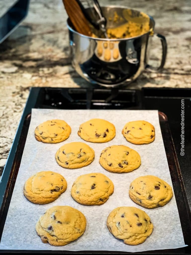 baking sheet of cookies with kitchenaid stand mixing bowl in the background