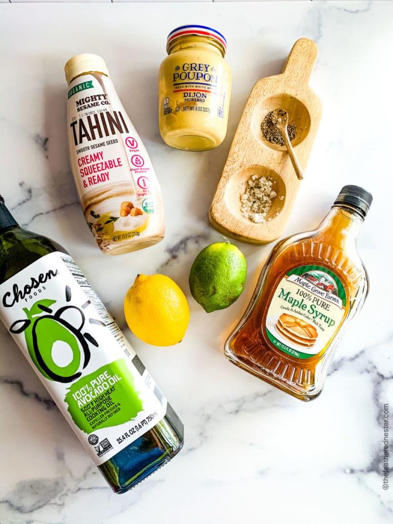 ingredients for creamy tahini dressing: tahini, avocado oil, lemon or lime, maple syrup, salt and pepper
