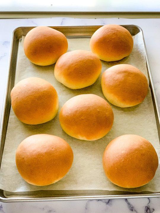 sheet pan of freshly baked hamburger buns