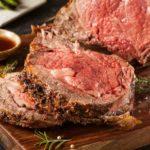 a prime rib roast sliced and ready to serve