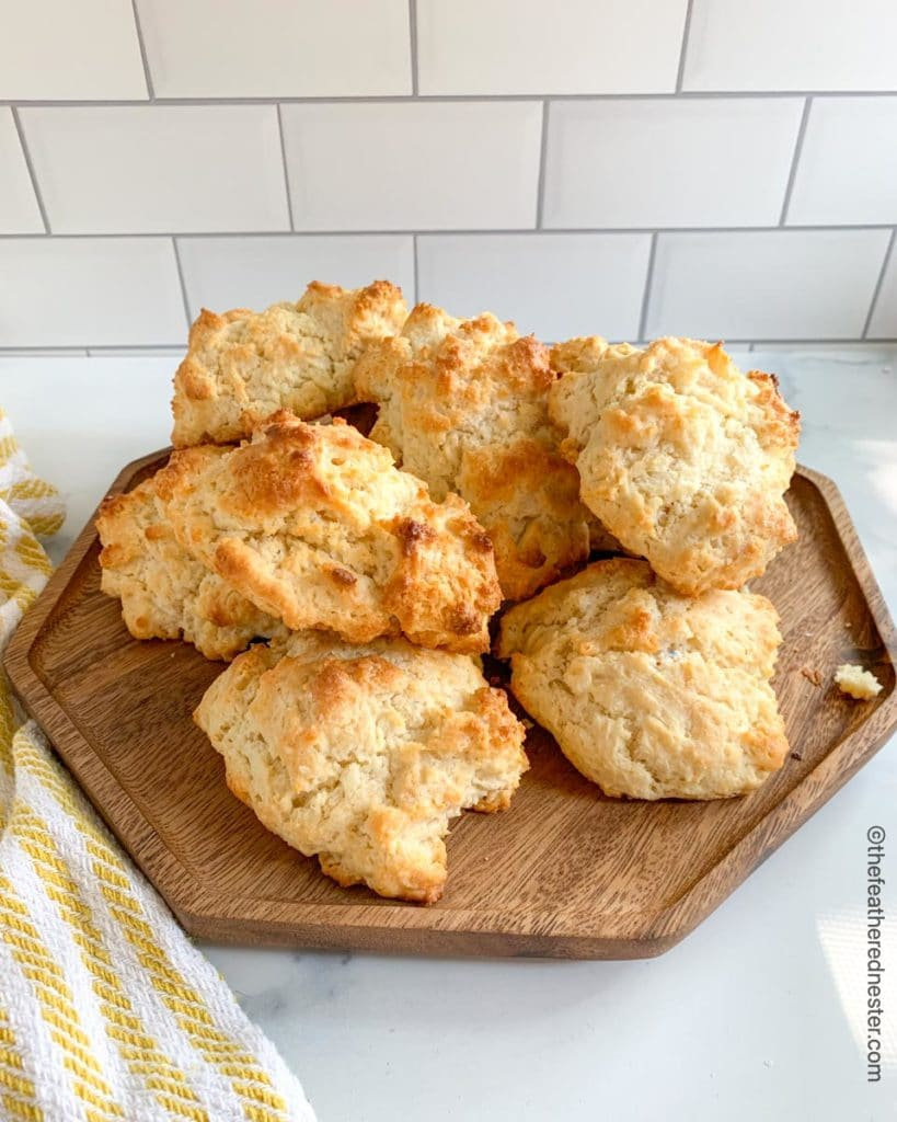 a wooden platter of drop biscuits made with Bisquick