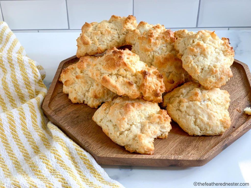 a wooden serving platter of Bisquick biscuits drop