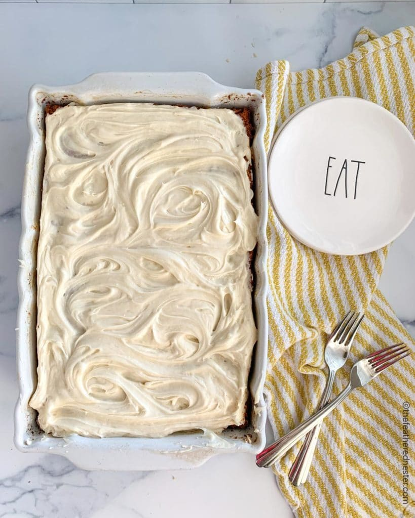 a cake pan with sourdough cake with cake plates and forks on top of a yellow and white striped napkin