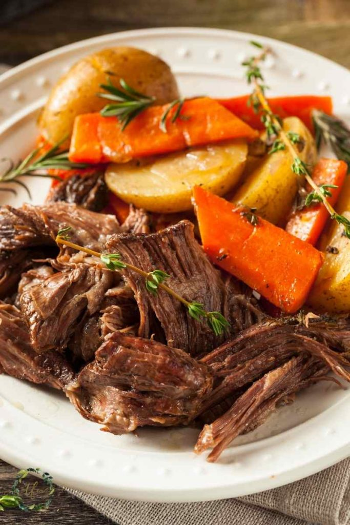 plate of pot roast chuck roast with carrots and potatoes