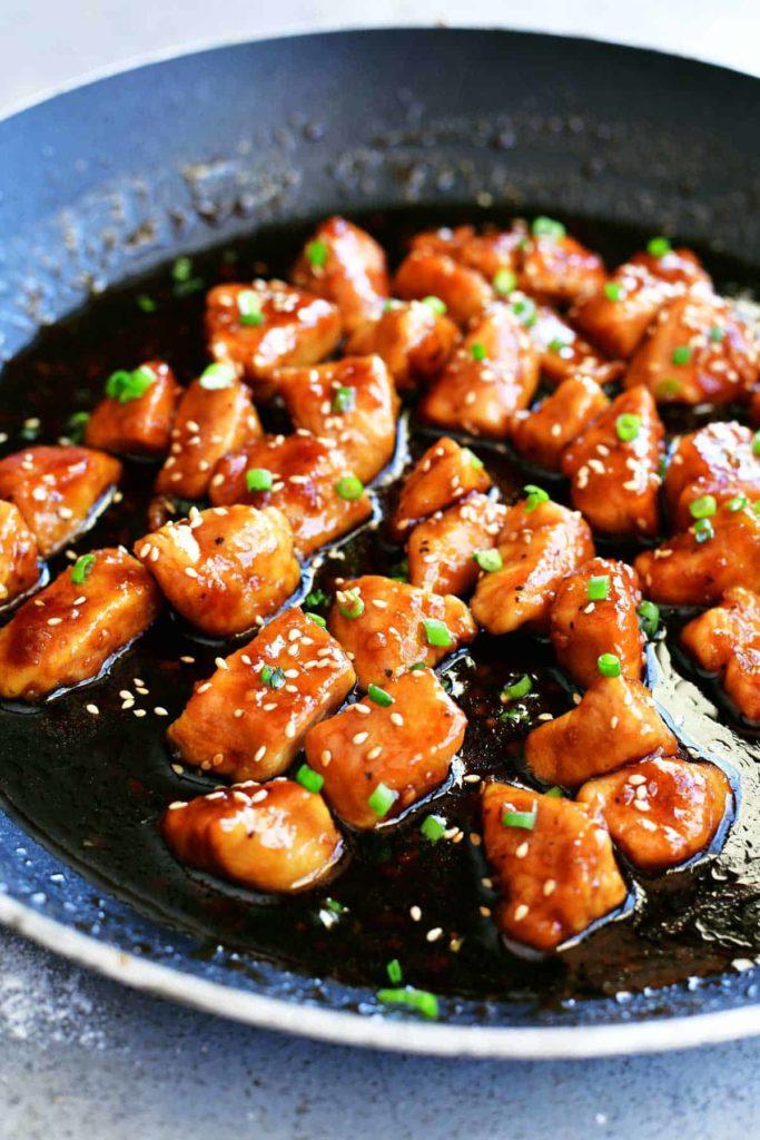 a skillet of honey garlic chicken tenderloins