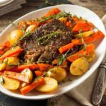 platter of pot roast with potatoes and carrots
