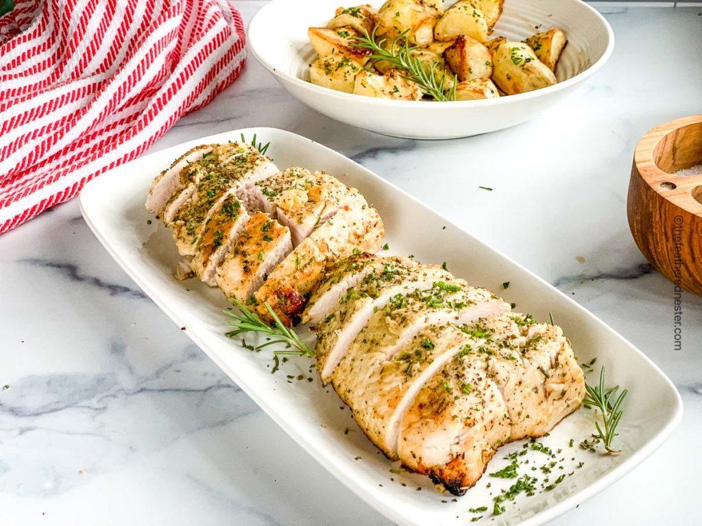 a sliced turkey tenderloin roast ready to serve