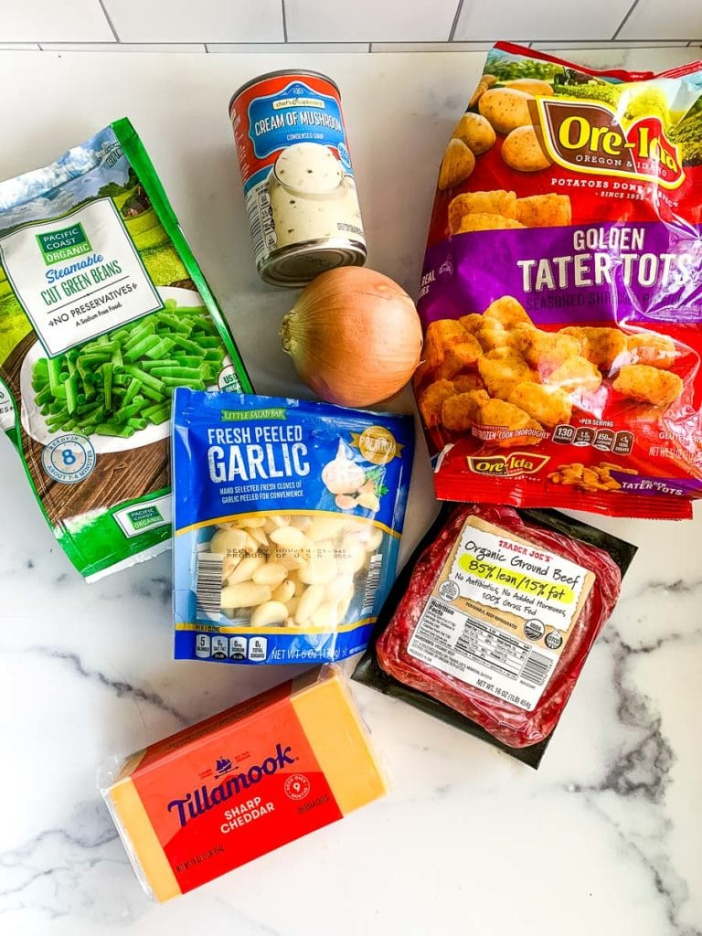 tater tots, cream of mushroom soup, frozen green beans, garlic, cheddar cheese, onion, and ground beef for a hot dish casserole recipe